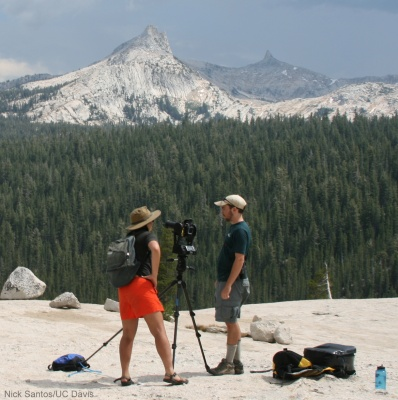 Center researchers Sarah Yarnell and Andy Bell taking ultra-high resolution photos of Tuolumne Meadows panorama. Yosemite's Mount Dana in background, 2013